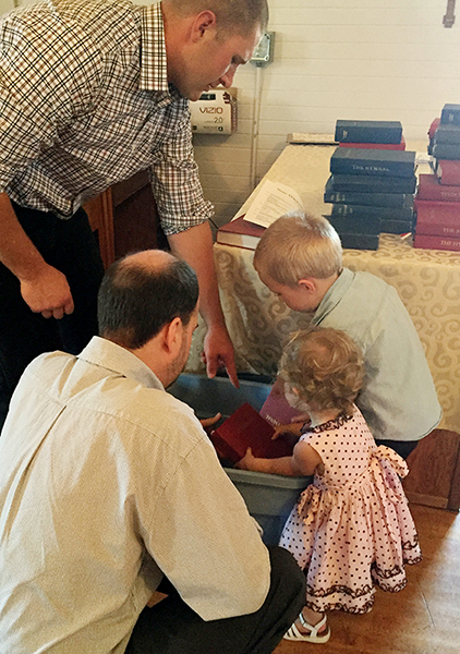 Little ones help put church away